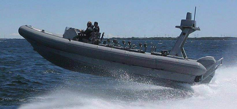 9M Special Forces RIB accelerates off a wave with twin 400 HP Mercs.